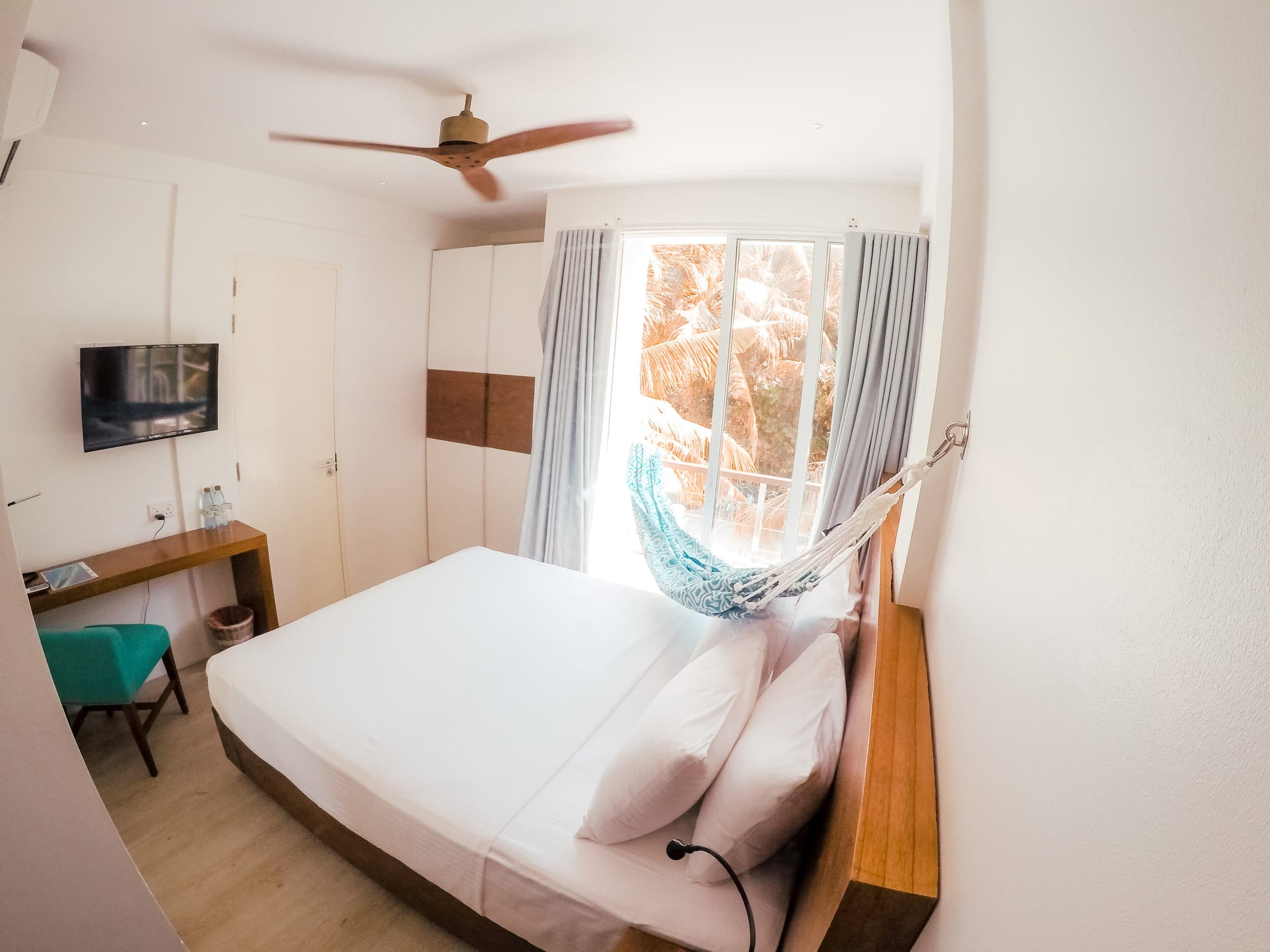 Compact Room - Image of one of Bliss' room types. Equipped with hammock, AC, TV and more